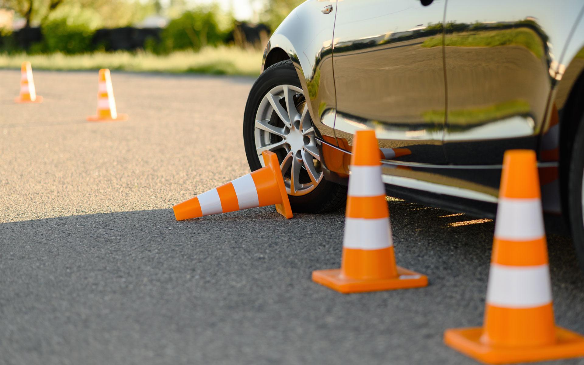https://ecoleconduitelenvol.com/wp-content/uploads/2021/02/car-and-downed-cone-driving-school-concept-UCVJ6P8.jpg